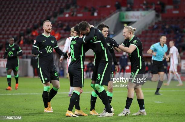 Wout Weghorst of VfL Wolfsburg celebrates with teammate Renato Steffen after scoring his team's second goal during the Bundesliga match between 1. FC...