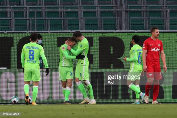 Wout Weghorst of VfL Wolfsburg celebrates with teammate Yannick Gerhardt after scoring his team's second goal during the Bundesliga match between VfL...