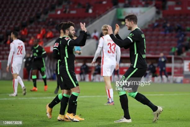 Wout Weghorst of VfL Wolfsburg celebrates with teammates after scoring his team's second goal Wolfsburg at RheinEnergieStadion on December 05, 2020...