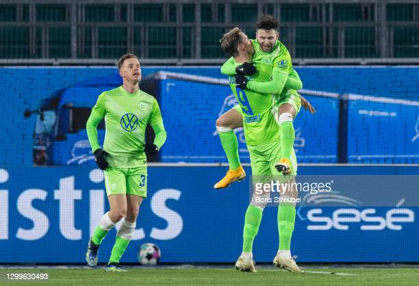 Wout Weghorst of VfL Wolfsburg celebrates with teammates after scoring his team's second goal during the Bundesliga match between VfL Wolfsburg and...