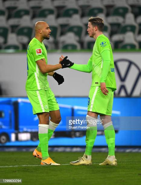 Wout Weghorst of VfL Wolfsburg is congratulated by team mate Maximilian Arnold after scoring their side's second goal during the Bundesliga match...
