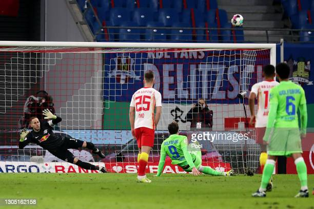 Wout Weghorst of VfL Wolfsburg misses a penalty during the DFB Cup quarter final match between RB Leipzig and VfL Wolfsburg at Red Bull Arena on...