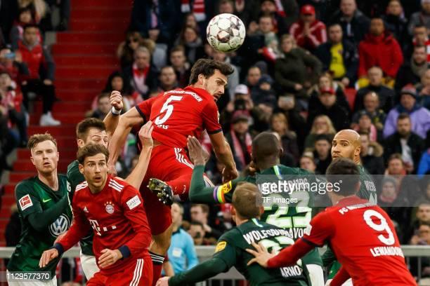 Wout Weghorst of VfL Wolfsburg Robin Knoche of VfL Wolfsburg Leon Goretzka of Bayern Muenchen Mats Hummels of Bayern Muenchen and Josuha Guilavogui...