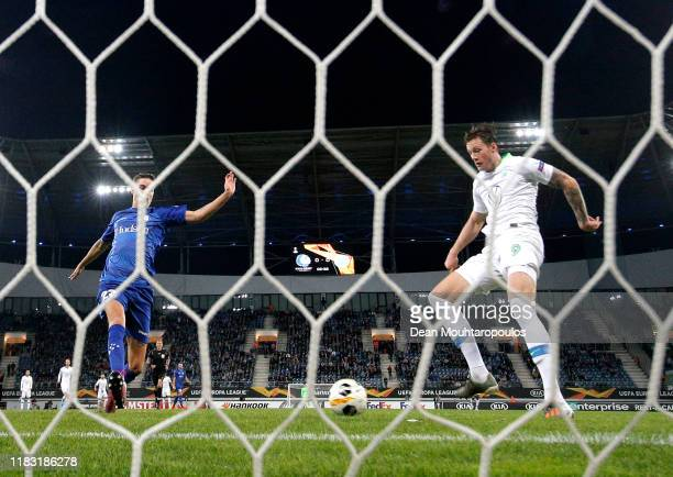 Wout Weghorst of VfL Wolfsburg scores his team's first goal during the UEFA Europa League group I match between KAA Gent and VfL Wolfsburg at...