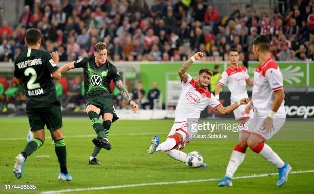 Wout Weghorst of VfL Wolfsburg scores his teams opening goal during the Bundesliga match between Fortuna Duesseldorf and VfL Wolfsburg at Merkur...