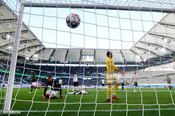 Wout Weghorst of VfL Wolfsburg scores his teams second and equalising goal past goalkeeper Yann Sommer of Borussia Monchengladbach during the...