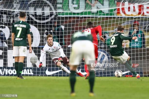 Wout Weghorst of VfL Wolfsburg scores his team's second goal during the Bundesliga match between VfL Wolfsburg and 1. FSV Mainz 05 at Volkswagen...