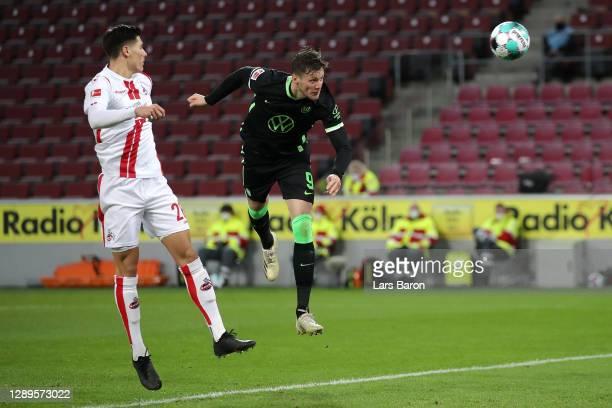 Wout Weghorst of VfL Wolfsburg scores his team's second goal during the Bundesliga match between 1. FC Koeln and VfL Wolfsburg at RheinEnergieStadion...