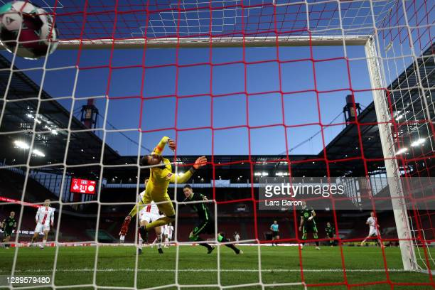 Wout Weghorst of VfL Wolfsburg scores his team's second goal past Timo Horn of 1. FC Koeln during the Bundesliga match between 1. FC Koeln and VfL...