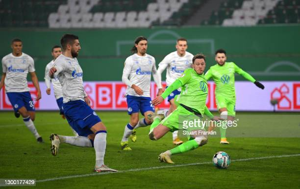 Wout Weghorst of VfL Wolfsburg scores their side's first goal during the DFB Cup Round of Sixteen match between VfL Wolfsburg and FC Schalke 04 at...