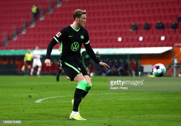Wout Weghorst of VfL Wolfsburg scores their side's first goal during the Bundesliga match between FC Augsburg and VfL Wolfsburg at WWK-Arena on...