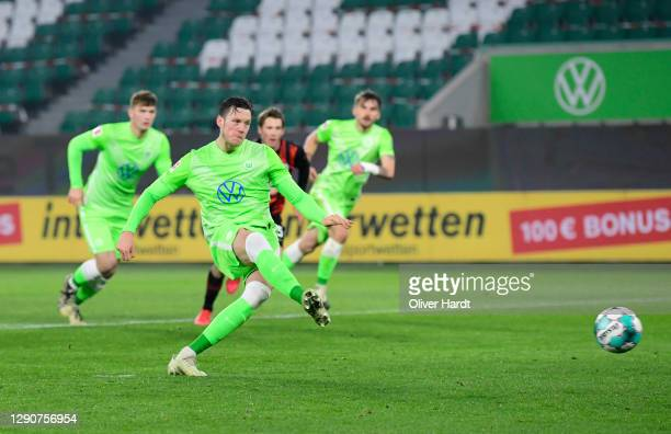 Wout Weghorst of VfL Wolfsburg scores their sides first goal from the penalty spot during the Bundesliga match between VfL Wolfsburg and Eintracht...