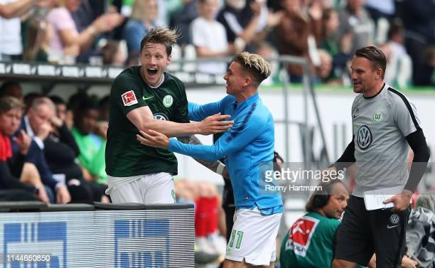 Wout Weghorst of Wolfsburg celebrates after scoring his team's opening goal with Felix Klaus of Wolfsburg during the Bundesliga match between VfL...