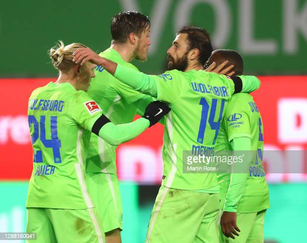 Wout Weghorst of Wolfsburg celebrates scoring the fourth goal with Xaver Schlager, Jérôme Roussillon and Admir Mehmedi during the Bundesliga match...