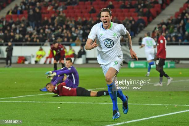 Wout Weghorst of Wolfsburg celebrates the final goal during the DFB Cup match between Hannover 96 and VfL Wolfsburg at HDIArena on October 30 2018 in...