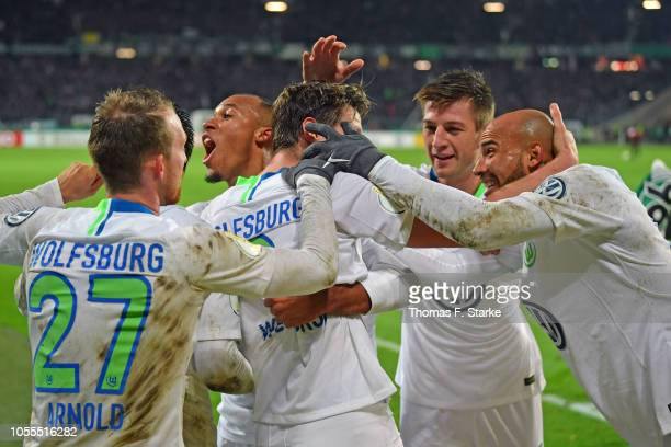 Wout Weghorst of Wolfsburg celebrates with his team mates the final goal during the DFB Cup match between Hannover 96 and VfL Wolfsburg at HDIArena...