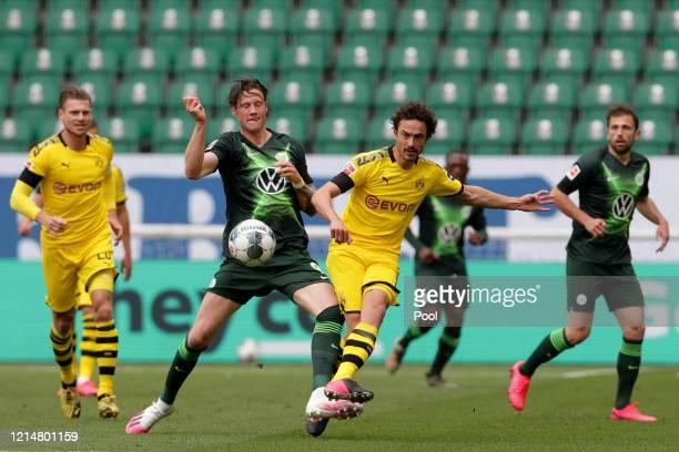 Wout Weghorst of Wolfsburg vies for the ball with Thomas Delaney of Borussia Dortmund during the Bundesliga match between VfL Wolfsburg and Borussia...