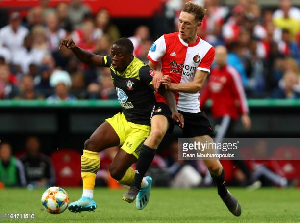 Wouter Burger of Feyenoord battles for the ball with Michael Obafemi of Southampton during the pre season friendly match between Feyenoord Rotterdam...