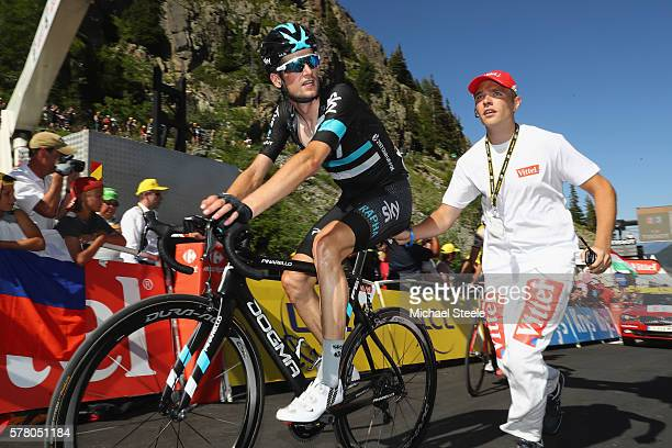 Wouter Poels of Netherlands and Team Sky is given a helping push after crossing the finishing line during the 1845km stage seventeen of Le Tour de...