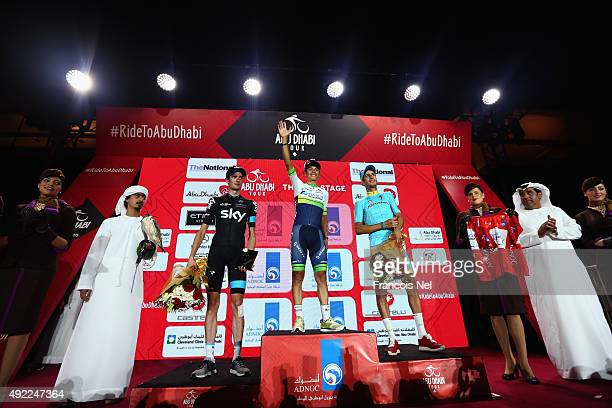 Wouter Poels of the Netherlands and Team Sky Esteban Chaves of Colombia and Orica Greenedge and Fabio Aru of Italy and Astana Pro Team celebrates on...
