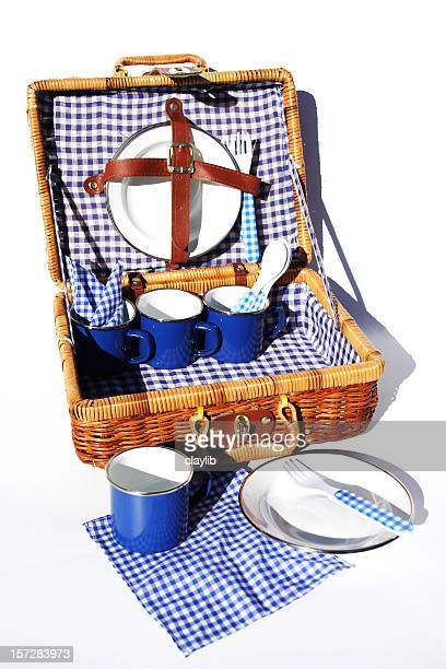 a woven case with blue checkered picnic supplies - picnic basket stock pictures, royalty-free photos & images