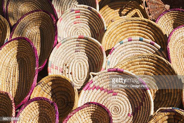 Woven plates on display for sale