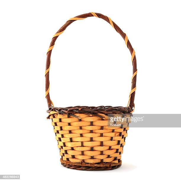 Woven wooden basket with handle on white background