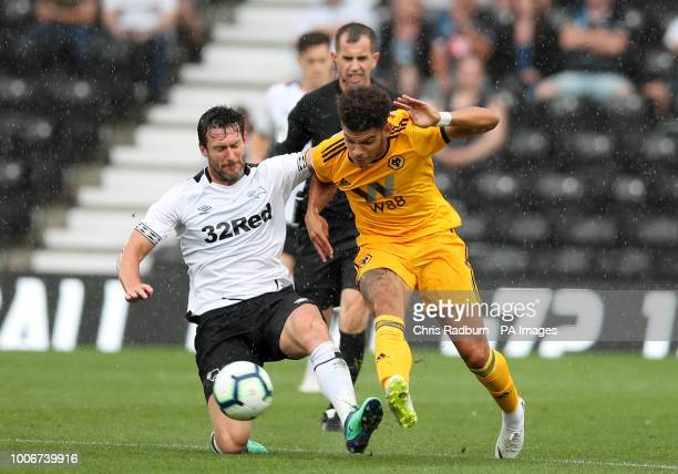 Woverhampton Wanderers Morgan Gibbs White is challenged Derby County's David Nugent during the preseason friendly match at Pride Park Derby