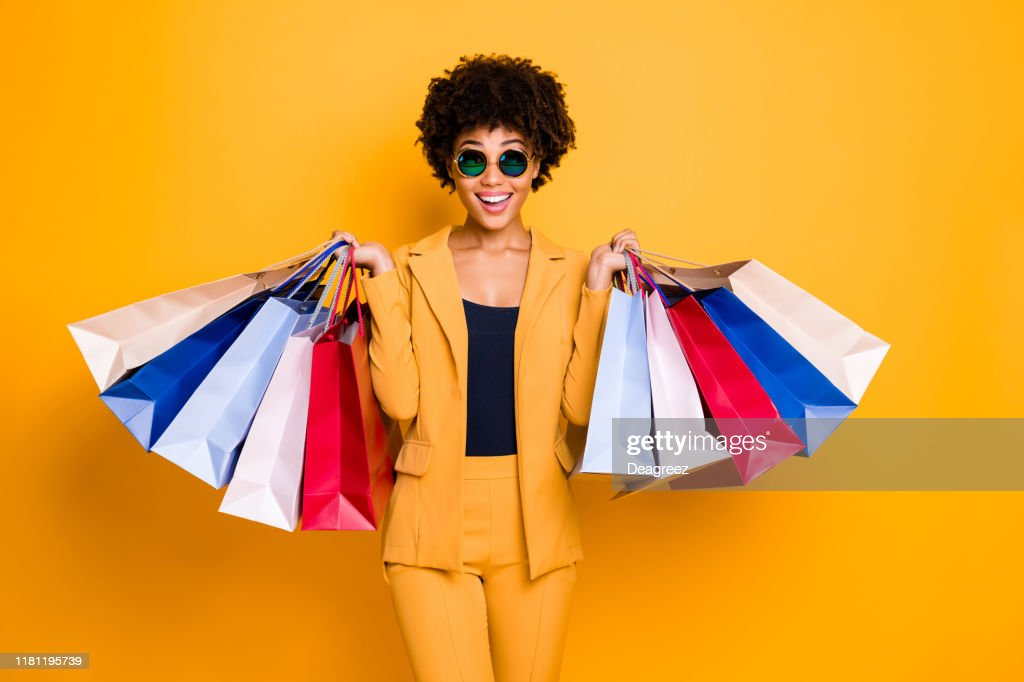 Wow omg 50 off. Portrait of surprised shocked brunette hair dark skin girl travel trip see sales black friday go shopping feel crazy wear style outfit trousers isolated bright color background : Stock Photo