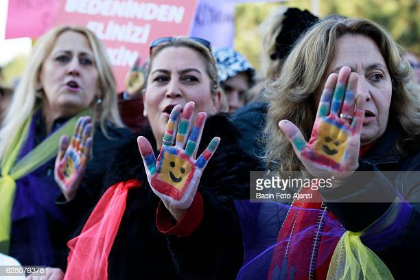Wowens show their hand painted to represent a child's face, Thousands of people protested the government outside the Turkey's parliament building for...