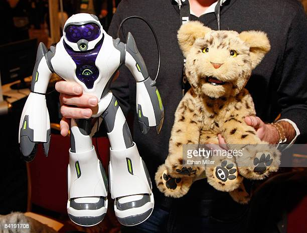 WowWee media representative Michael Rush displays a Joebot the next generation of the company's biomorphic Robosapien and a new WowWee alive line...