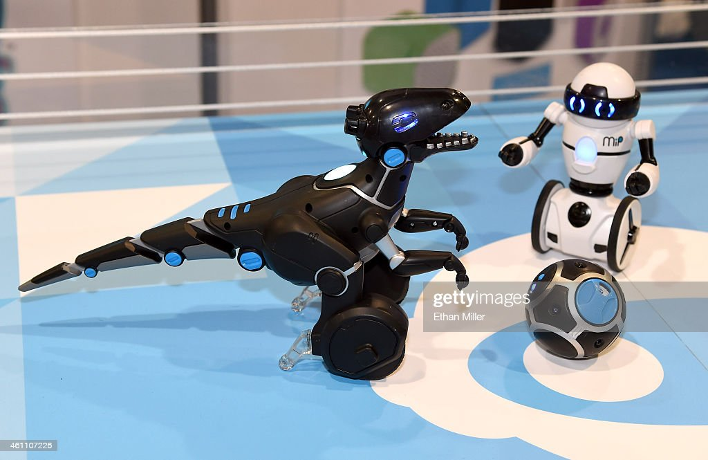 WowWee's new MiPosaur smart robotic creature (L) and the MiP balancing commercial robot are displayed at the 2015 International CES at the Sands Expo and Convention Center on January 6, 2015 in Las Vegas, Nevada. The MiPosaur comes with BeaconSense technology that allows it to chase around and play with a trackball that comes equipped with different modes. It can also be controlled by hand with GestureSense technology and will be available in August 2015 for USD 120. CES, the world's largest annual consumer technology trade show, runs through January 9 and is expected to feature 3,600 exhibitors showing off their latest products and services to about 150,000 attendees.