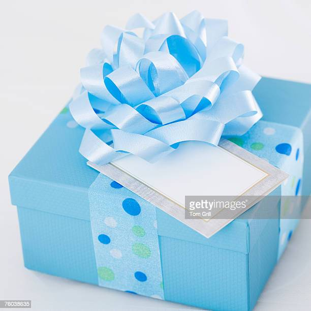 Wrapped blue present with gift tag, close-up