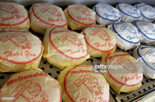 A wrapped cheeseburger and hamburger display sits inside the McDonald's USA First Store Museum April 14 2005 in Des Plaines Illinois The McDonald's...