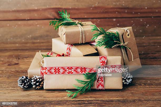 Wrapped Christmas gifts on a wooden table