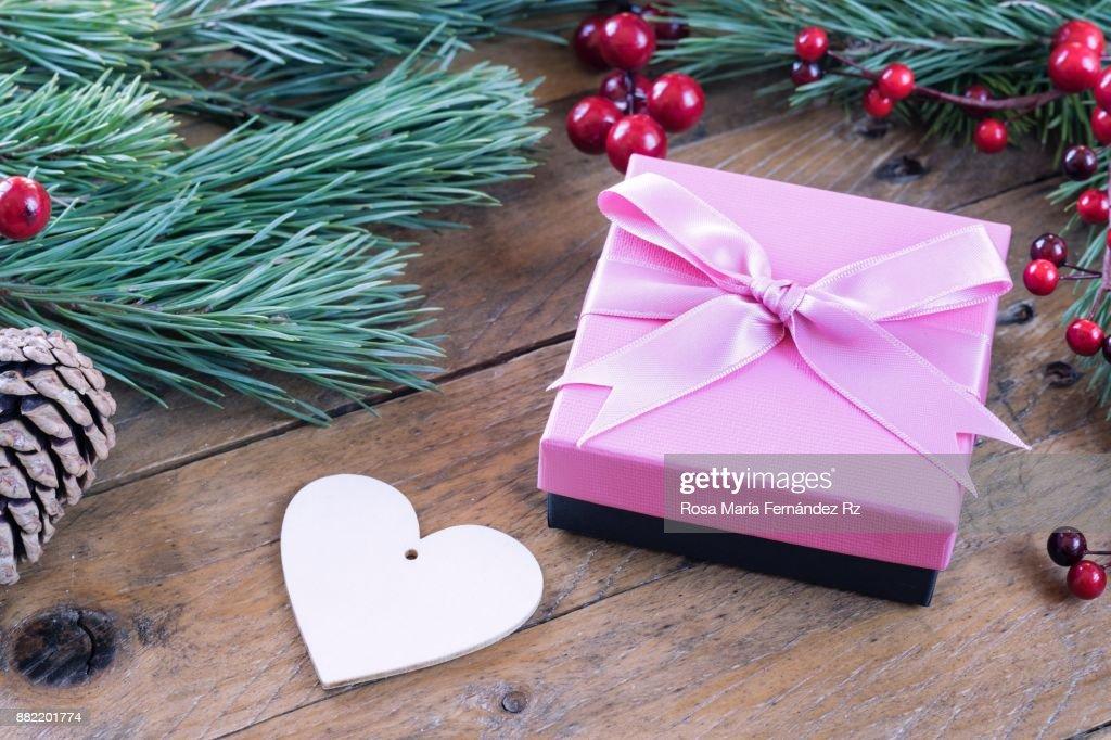 Wrapped Christmas Present Heart Shape Fir Tree Branches Mistletoe