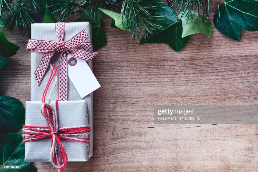 Wrapped Gift Boxes Ivy Leaves Fir Tree Branches On Vintage Wooden