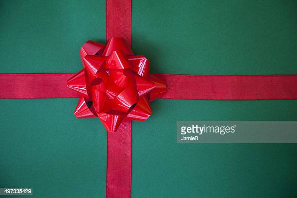 wrapped gift with a red bow