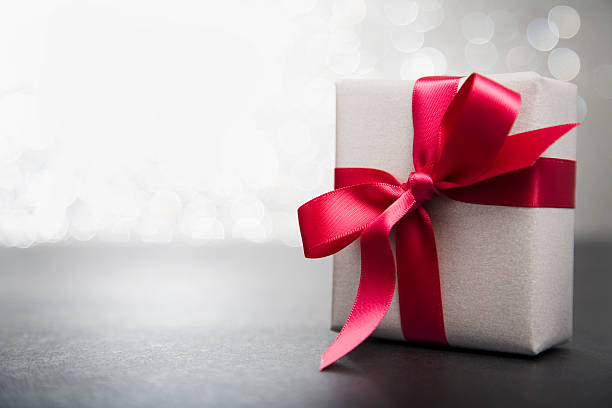 wrapped gift with red ribbon - free images without copyright stock pictures, royalty-free photos & images