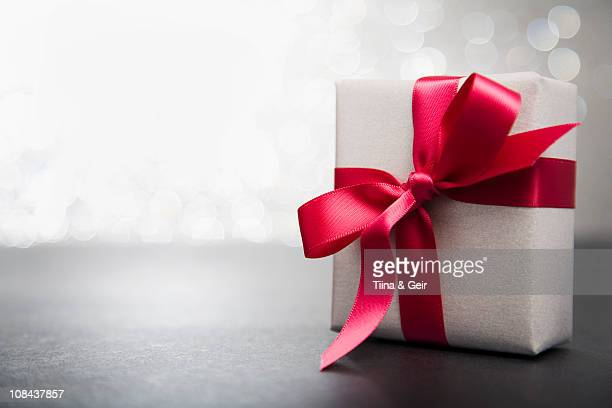wrapped gift with red ribbon - gift stock pictures, royalty-free photos & images