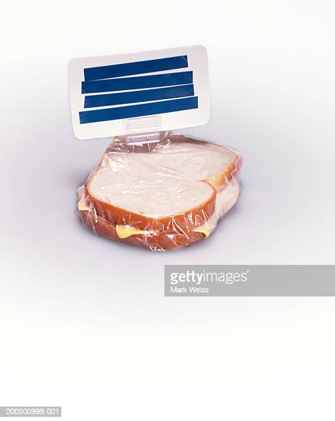 Wrapped ham and cheese sandwich with covered sign