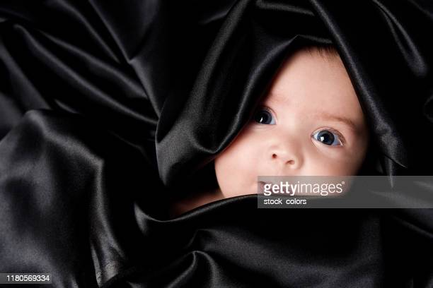 wrapped in black silk - hazel eyes stock pictures, royalty-free photos & images
