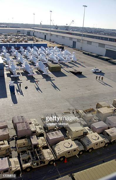 Wrapped in plastic shrink wrap US Army Black Hawk helicopters as well as vehicles of all types line a dock January 14 2003 at the Port of Savannah...