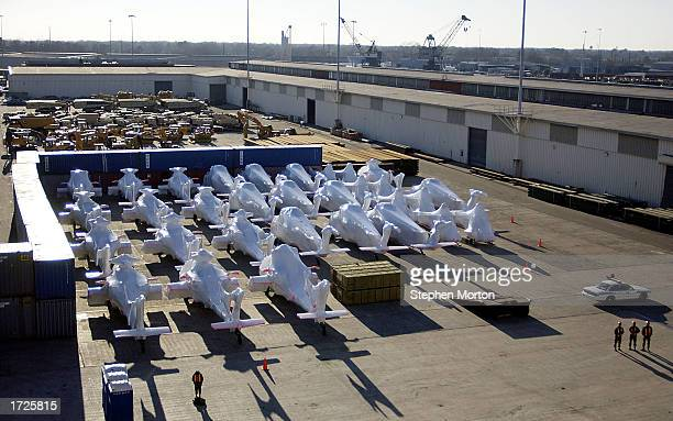 Wrapped in plastic shrink wrap US Army Black Hawk helicopters as well as vehicles of all types sit on a dock January 14 2003 at the Port of Savannah...