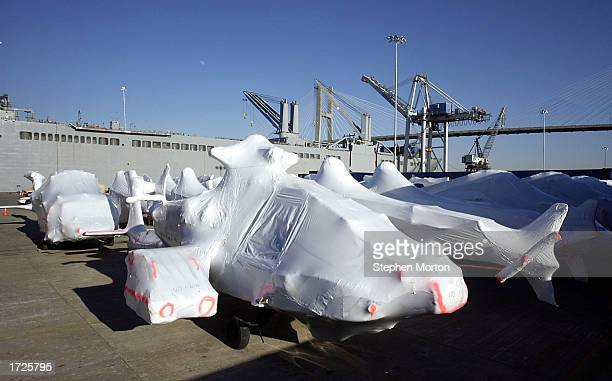 Wrapped in plastic shrink wrap US Army Black Hawk helicopters line a dock January 14 2003 at the Port of Savannah Georgia The aircraft were waiting...
