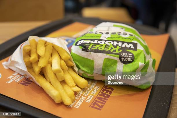 A wrapped meatfree Rebel Whooper sits on a tray next to a portion of fries at a Burger King Holdings Inc fastfood restaurant in Milan Italy on...