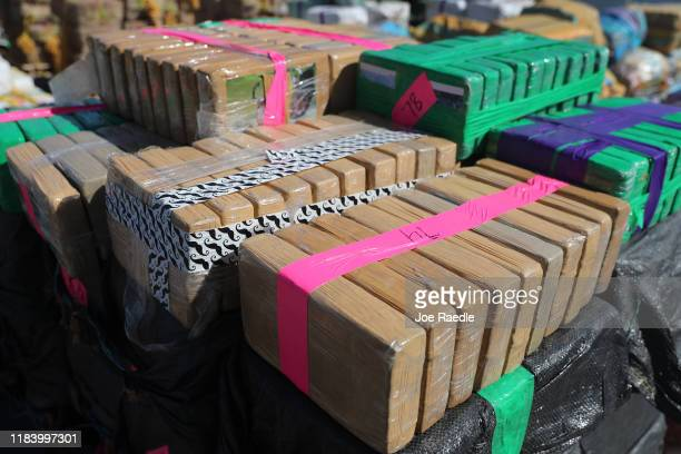 Wrapped packages of some of the 27,300 pounds of seized cocaine are seen on the deck of the Coast Guard Cutter James as they prepare to off load it...