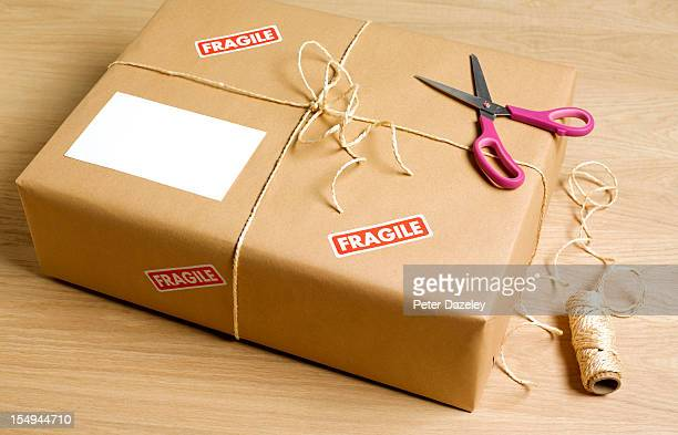 wrapped parcel with copy space - brown paper stock pictures, royalty-free photos & images