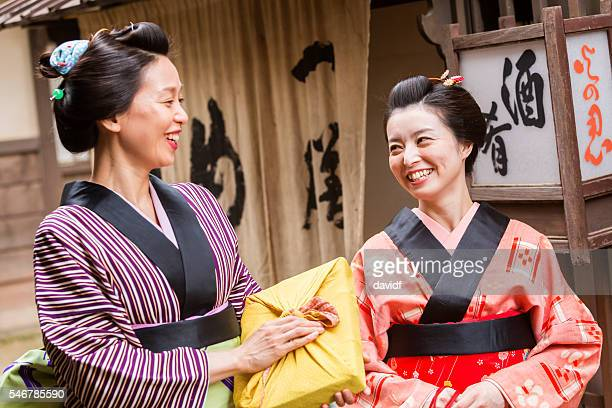 Wrapped Parcels With Traditional Japanese Women in Kimonos