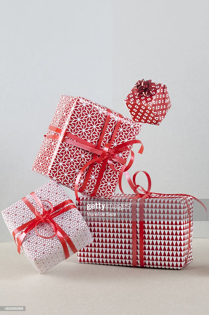 Wrapped presents balancing : Stock Photo